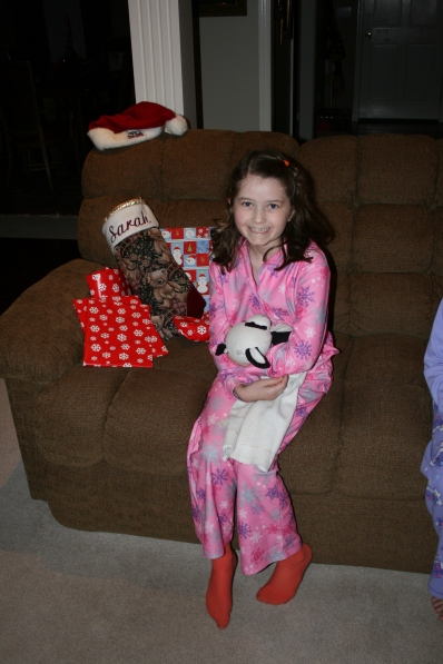 "Sarah and ""Bessie"" waiting to open gifts"